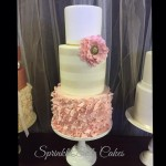 pink ruffle white stripes wedding cake